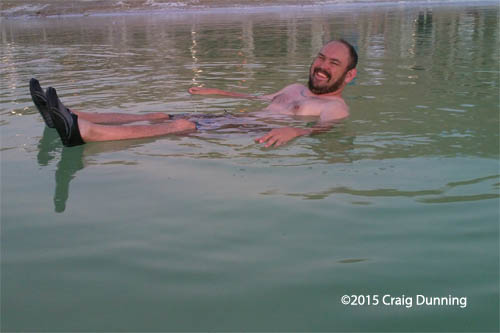 Heath Johnson of Paris, Texas laughs at the sensation of floating in the Dead Sea. (Photo: ©2015 Craig Dunning)